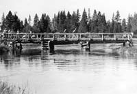 completing a bridge across the Deschutes River