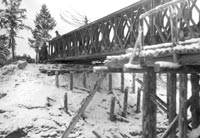 Side view of 110 foot triple single Bailey Bridge being built by Co B