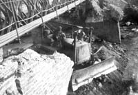 D-7 dozer being used to clear rubble from the old pier for the construction of a Candol Bridge