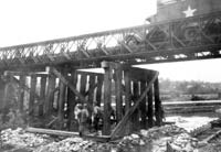 Co. B erecting bents for a Candol Bridge 3 miles southwest of St Lo