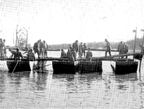 Engineers construct a heavy ponton bridge at Fort Belvoir