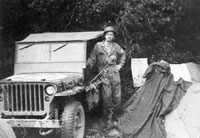 J R Bell and his jeep
