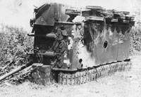 Knocked out German tank turned over to show escape hatch