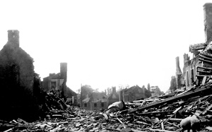 Allied bombing destroyed town, most likely in Normandy, France