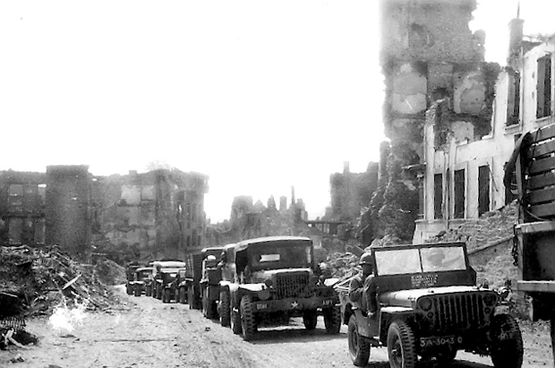 A U.S. convoy moving through a liberated town