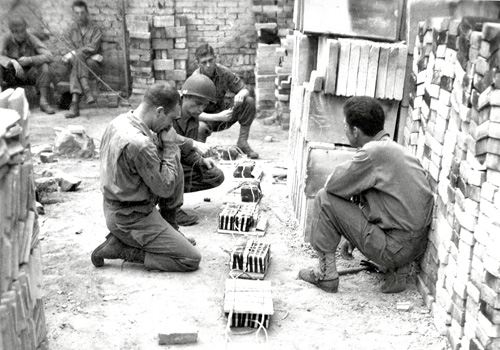 Engineers prepare explosives for demolition