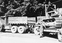 Winton Yelton and Charlie Palmer with Diamond T hauler and dozer