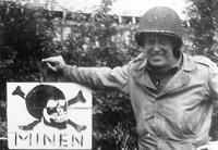 Sgt. James Coughlin with German minefield sign