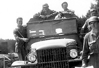 Co. A truck with a few of the men of the 300th