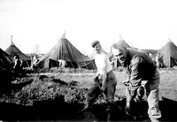 Digging ditches in Tent City, Swindon, England