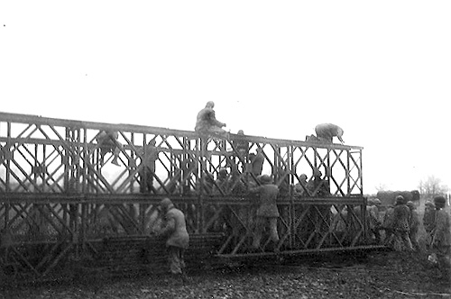Engineers setting up a Bailey Bridge