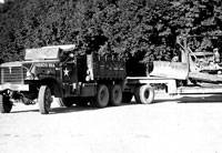 Diamond T hauler and dozer of the 300th Engineers